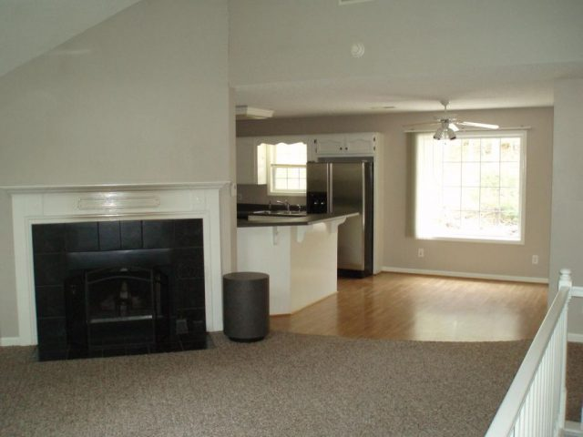 living area fireplace into kitchen
