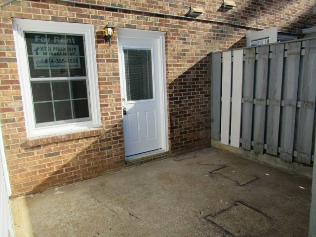 rear entrance with patio