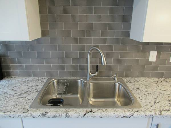 drop in stainless steel sink tile backsplash